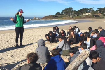 Junior Researchers with program leader Mara at the beach