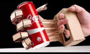 Robot hand holding a can of soda